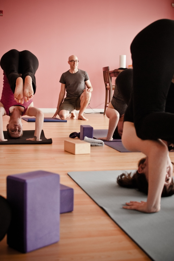 Yoga students in headstand