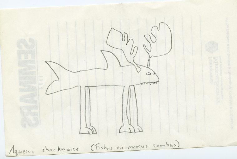 Picture of half-shark, half-moose on the back of a notepad.